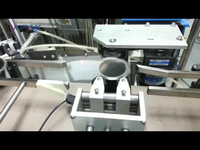 Applicatore automatico di etichette adesive a doppia tazza conica